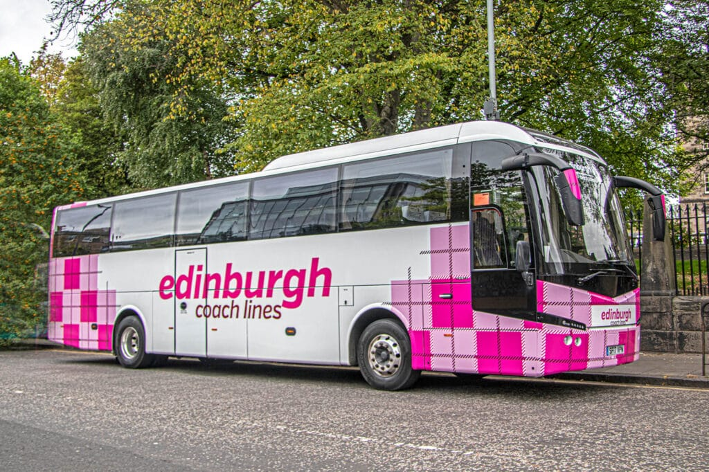 pink and white edinburgh Coach Lines coach